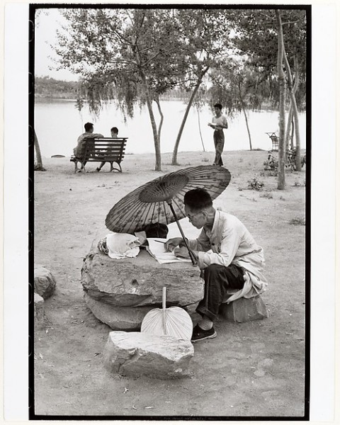 A Professor Corrects His Class Papers by the Lake in the Newly Build King Chan Park, Peking, Henri Cartier-Bresson, 1958, printed ca. 1972