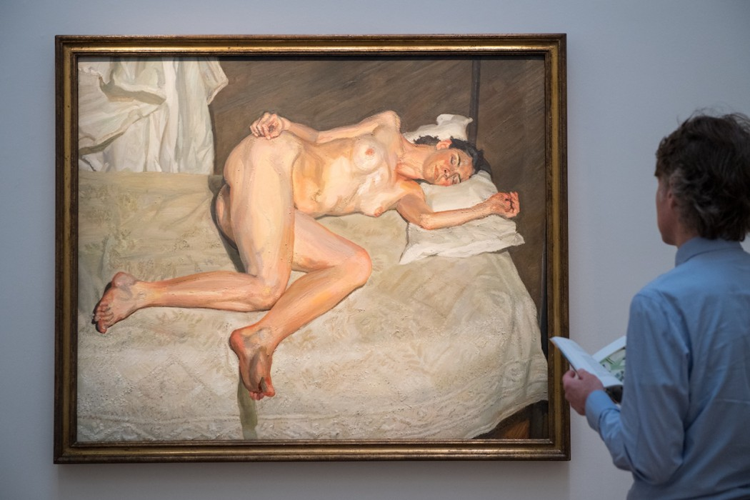 LONDON, ENGLAND - JUNE 14:  Art handlers adjust 'Portrait on a white cover' by Lucian Freud (estimated at £17 million to £20 million) during a preview of the Contemporary Art sale at Sotheby's on June 14, 2018 in London, England. The sale will take place on 26 June 2018 and includes works by artists Hockney, Freud and Basquiat.  (Photo by Chris J Ratcliffe/Getty Images for Sotheby's)